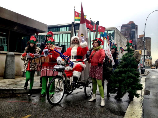 Joey Skaggs Pedals Mobile Missile Launcher Flanked by Singing Elves