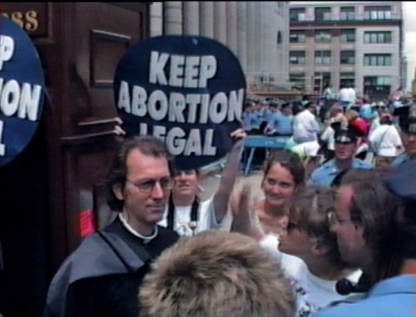 Father Joseph (aka Joey Skaggs) with his Portofess attacked by angry feminists at Democratic National Convention