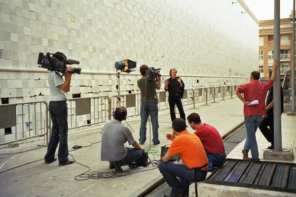 Joey Skaggs interviewed by local media outside EACC Museum during his exhibition, October 2002