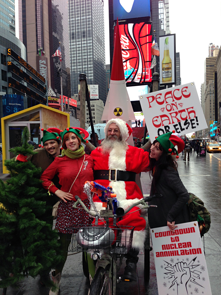 "Joey Skaggs as Santa with his ""elves"" in his Santa's Missile Tow protest at Times Square"